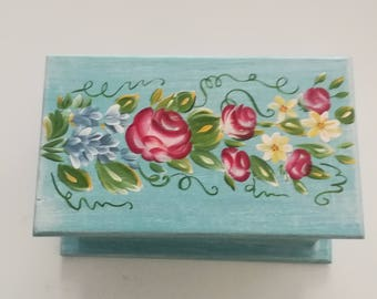 wooden box with roses and flowers decor
