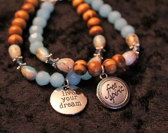 A Beautiful 2 Piece Set of Wood and Glass Bead Bracelet with Charms was 20.00