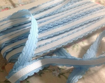 Old, white and pale blue ribbon, lingerie