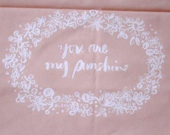 embroidery pattern on fabric You Are My Sunshine white on peach