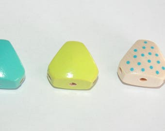 6 holes for arms and legs making triangular wooden beads