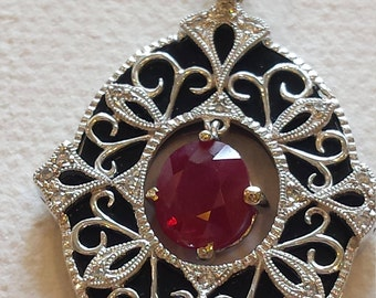18 k white gold diamond  onyx  and ruby pendant