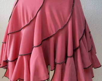 This is a peach color mini skirt with ruffled edging plus made in USA   (v188)