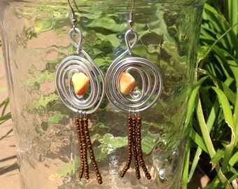 Sea Spiral earrings with copper fringe