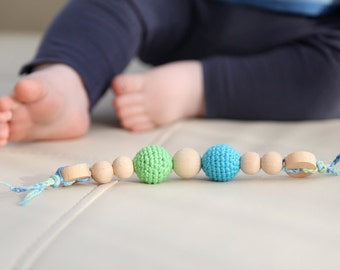 Teething toy with crochet wooden bead. Blue and green.