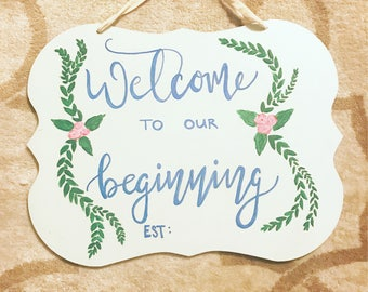 Newlyweds, wedding sign, first home