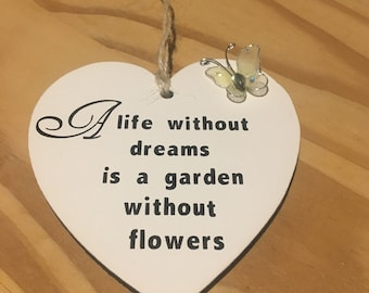 A life without dreams is a garden without flowers hanging heart plaque.