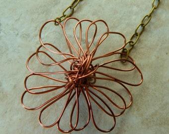 sculptural antique copper wire daisy pendant on vintage style chain