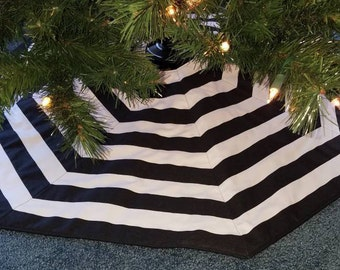 "Black and White stripe tree skirt. 42"" wide"