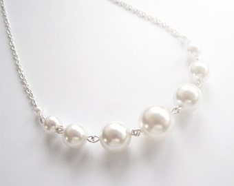Elegant white pearl necklace on silver chain