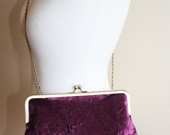 Hand printed clutch bag in a deep aubergine velvet with a foliage design