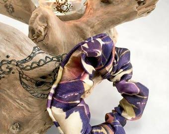 Purple hair tie