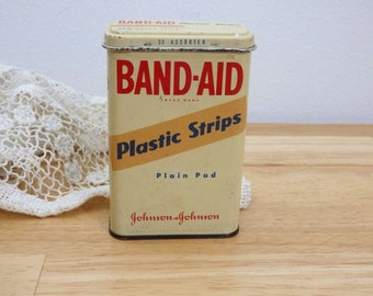 Vintage Band-Aid Tin. (Mid-Century Metal First-Aid Bandage Johnson kit 60's 70's retro set dressing box storage advertising ephemera