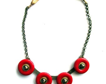 Plastic red and gold necklace