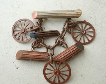 Vintage Art Deco Era celluloïd broche Western Dangle journaux Wagon roues livraison gratuite