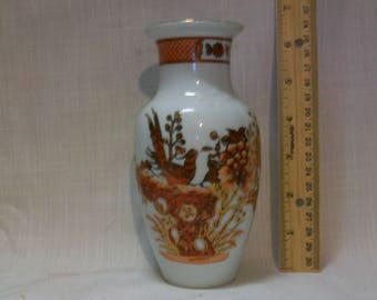 "Listing 126 is a Chinese porcelain vase 6"" H"