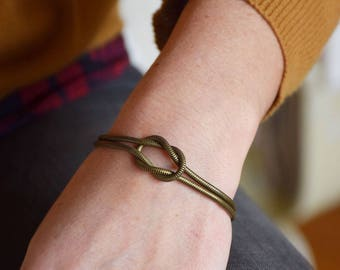 Bronze plated brass bow on a tubular chain bracelet