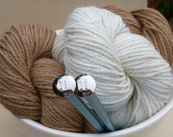 100% Alpaca Yarn; super-soft, 3 ply worsted/aran weight (8 WPI) 150 yards/skein, 2 natural (undyed) colors: Golden Fawn, Creamy White