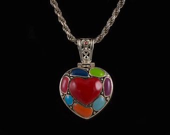 Heart necklace 92.5 Silver Italy Enclosed heart has enameled shapes on one side and silver filigree on the other Hollow bale on hinge Nice