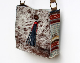 NEW hair-on speckled cowhide bag with colorful textile side panels and tassel detail