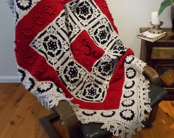 "As You like It Afghan, a unique crochet blanket in cherry red, black and linen fleck wool, measuring 52"" x 52"".  Textured and richly colored"