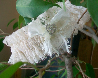 Wedding garter  Brides garter  Luxurious ruffles   Ivory lace  Bridal lingerie  Sheer white ribbon and  Rhinestone heart garnish