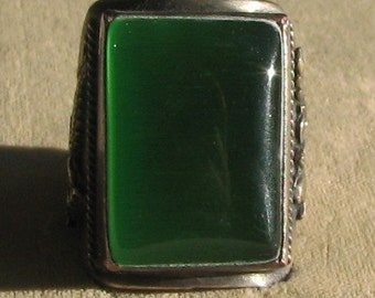 A Large Asian Ring with a Green Opalescent Like Peking Glass