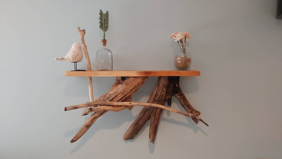 Handmade hanging shelf made with cedar top and driftwood accents.