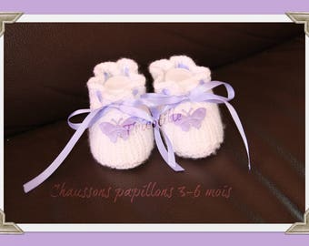 White slippers, butterflies and purple satin ribbon