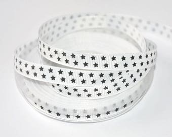 1 meter Ribbon 10mm black star print white grain