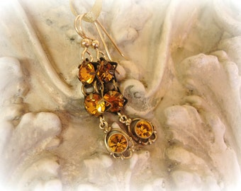 golden one of a kind vintage assemblage earrings golden topaz rhinestones gold filled ear wires