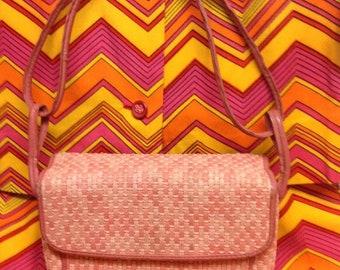 Pink handbag with leather details