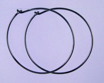 Large KISS hoops: Black niobium hoop earrings