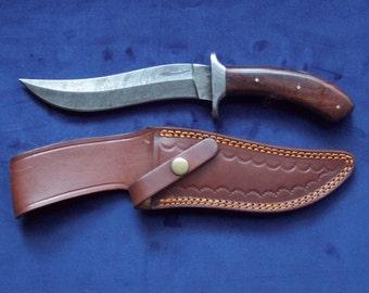 Custom handmade Damascus steel skinning knife a with heavy duty custom hand tooled leather sheath