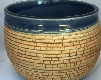 Handmade, wheel thrown planter.  contrasting texture and glaze
