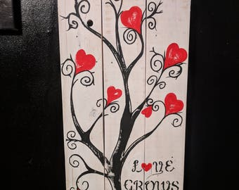 Love grows here wall art.