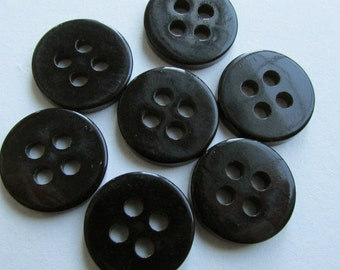 7 black vintage buttons