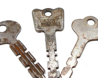 "3 keys, Different old metal flat keys, for altered art or jewelry, crafts. 2""."