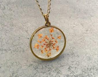Orange Queen Anne's Lace in a slim Antique Bronze Open-Back Bezel Resin Necklace, Christmas