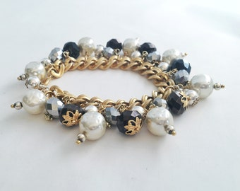 Chain link gold bracelet with repurposed vintage beads.  Faux pearls, black and silver crystals.  Beautiful special occasion jewelry.