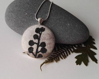 Hand Made Nuno Felt Pendant in White and Grey with Black Botanical Design