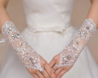 A pair white or off white beaded wedding lace gloves / bridal floral lace gloves is for sale. Sold By pair
