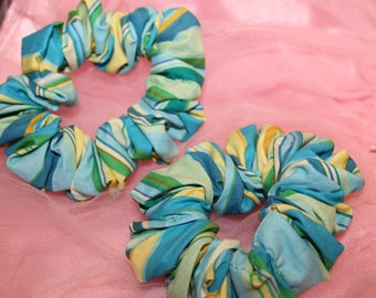 The colors green/blue/yellow fabric hair scrunchie