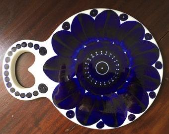 A Trivet cutting board in Arabia Finland Valencia Design