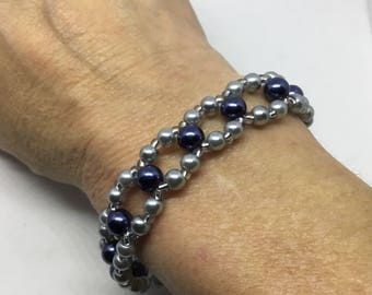 Shades of blue glass pearl double strand bracelet.  Luxurious - Lustrous - Gleaming.  Braid Loop design