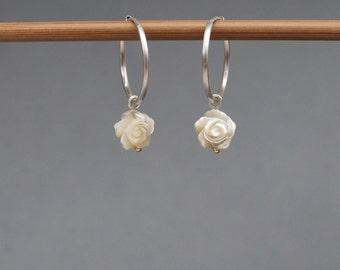 Mother of pearl roses with a hint of gold on satin finished sterling silver hoops.