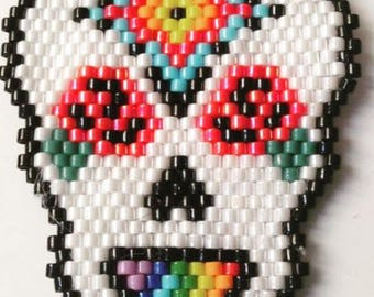 Skull Rainbow mounted as a brooch, woven with Miyuki