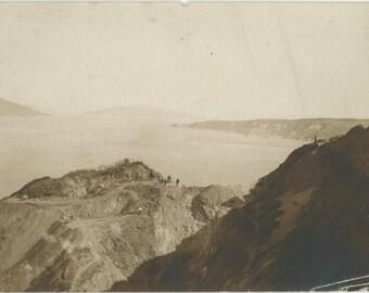 Distant Figures Working on Cliffs, c1910s: Vintage Snapshot Photo [81639]