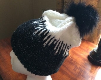 Black and white sparkly winter hat with removable pom