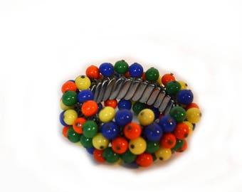 Cha Cha Bracelet Rainbow Colored Glass Bead Expansion Bracelet